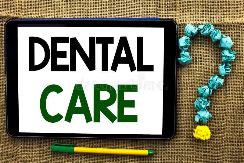 Escrita conceptual da mão que mostra cuidados dentários Da boca oral do dente do texto da foto do negócio wri de inquietação dos  imagem de stock