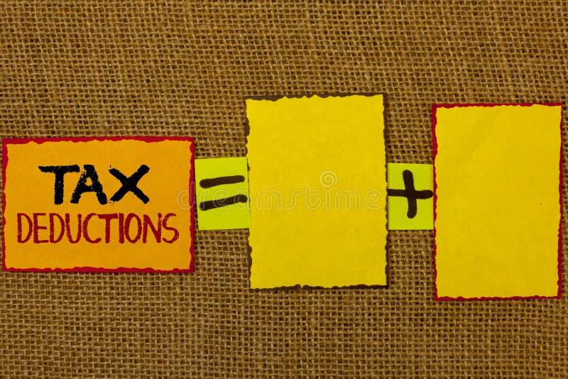 Escrita conceptual da mão que mostra deduções fiscais A redução apresentando da foto do negócio no dinheiro das economias do inve foto de stock royalty free