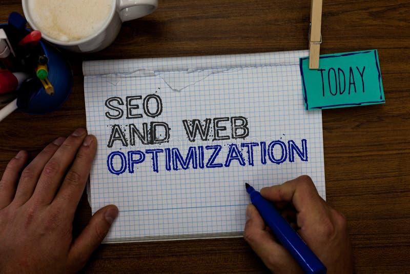 Escrita conceptual da mão que mostra Seo And Web Optimization Estratégias de marketing apresentando de Keywording do Search Engin fotografia de stock