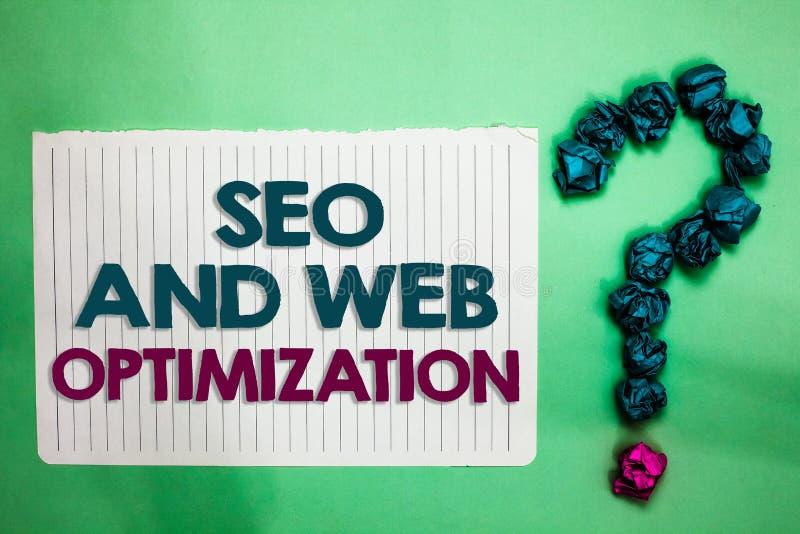 Escrita conceptual da mão que mostra Seo And Web Optimization Estratégias de marketing de Keywording do Search Engine do texto da foto de stock