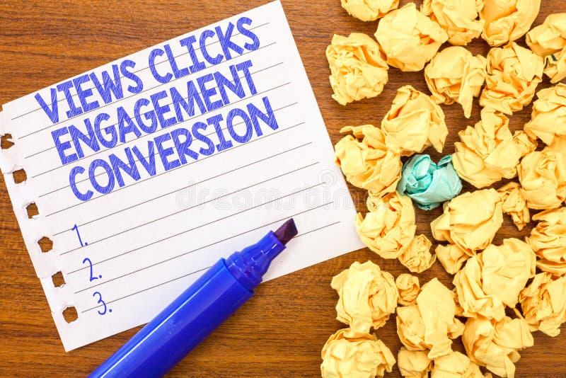 A escrita conceptual da mão que mostra vistas clica a conversão do acoplamento Otimização social da plataforma dos meios do texto foto de stock royalty free