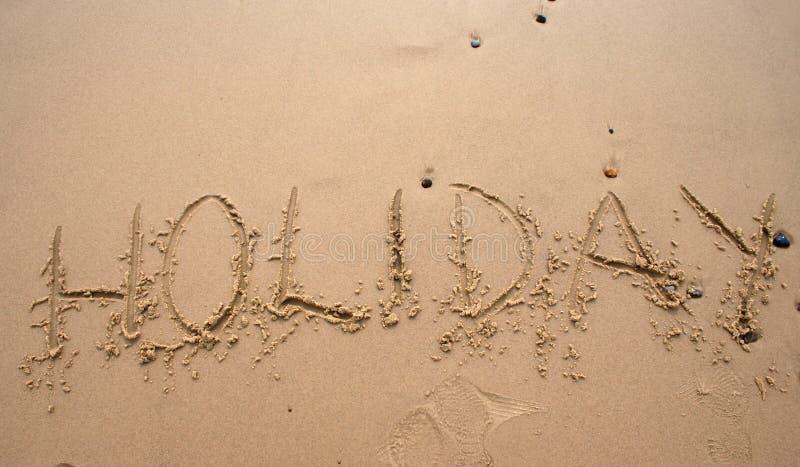 Escrita da areia - Holoday fotografia de stock
