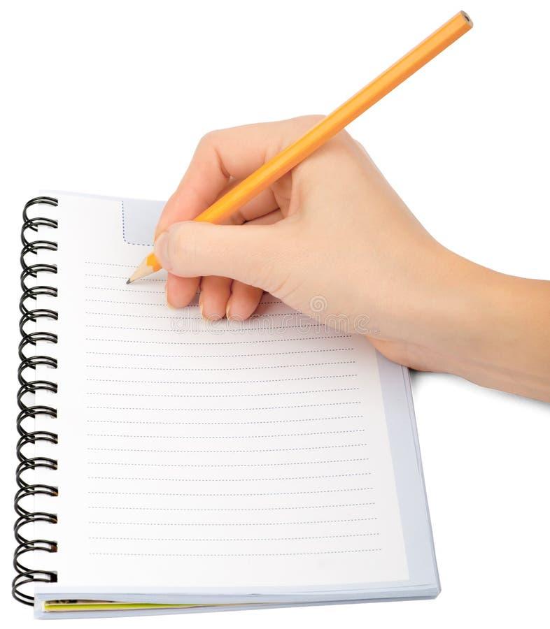 Escrita da mão no caderno no fundo branco imagens de stock royalty free