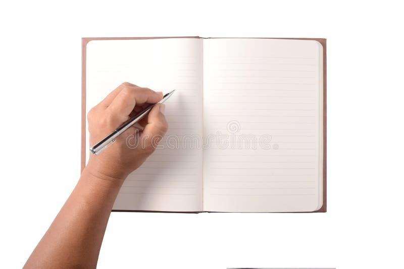Escrita da mão no caderno vazio foto de stock royalty free