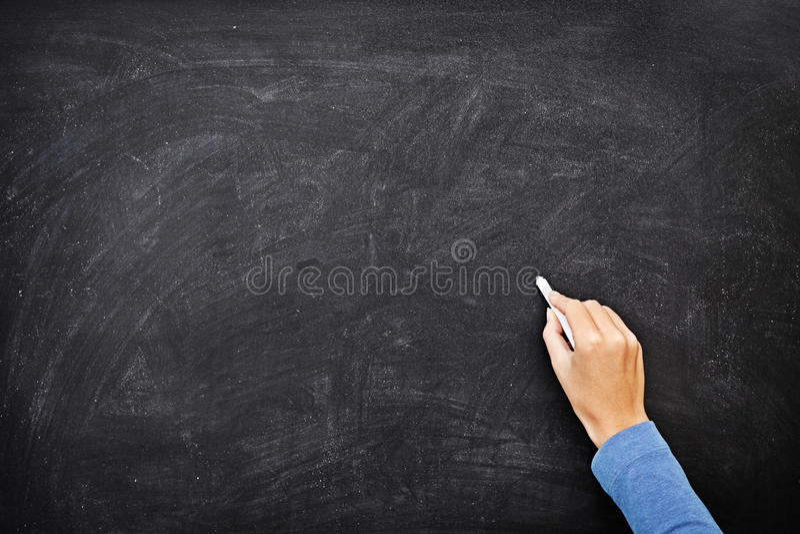 Escrita da mão no espaço em branco da cópia do quadro-negro imagem de stock