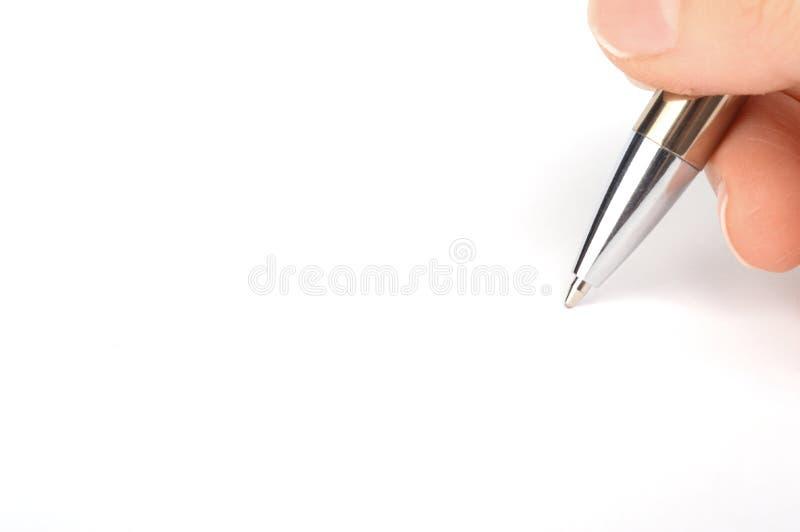 Escrita da mão no Livro Branco fotos de stock