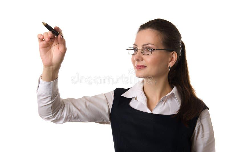 Escrita da mulher de negócio no backgroun isolado branco fotografia de stock royalty free