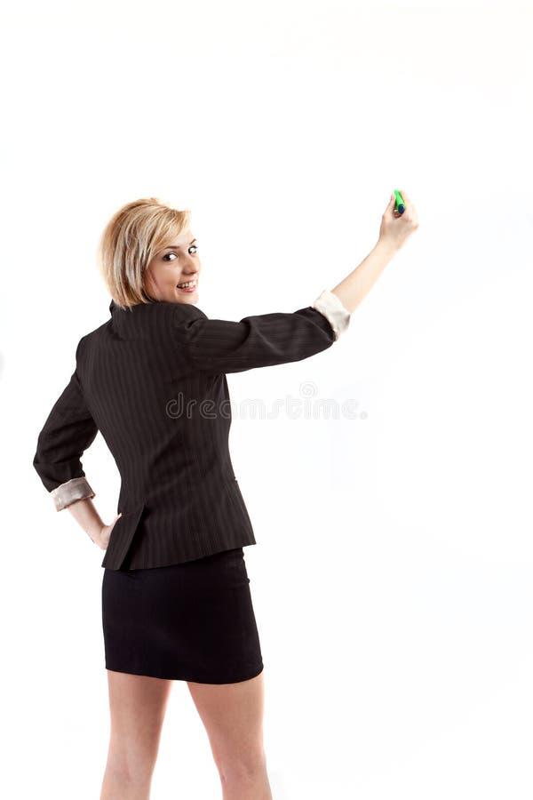 Escrita da mulher de negócios foto de stock