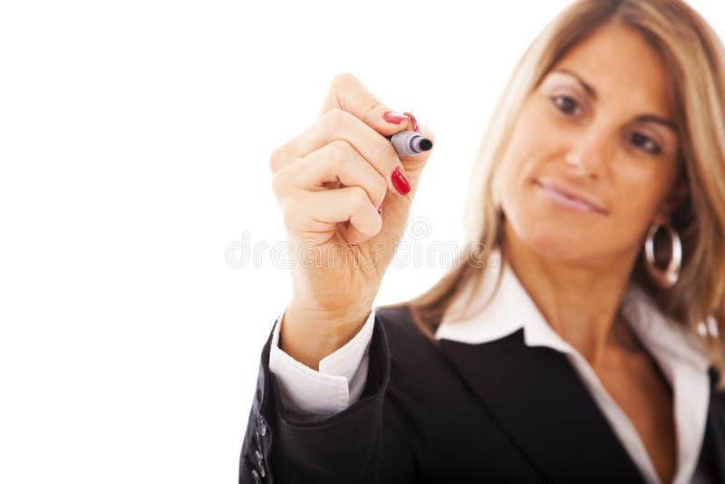 Escrita da mulher de negócios no whiteboard imagens de stock royalty free