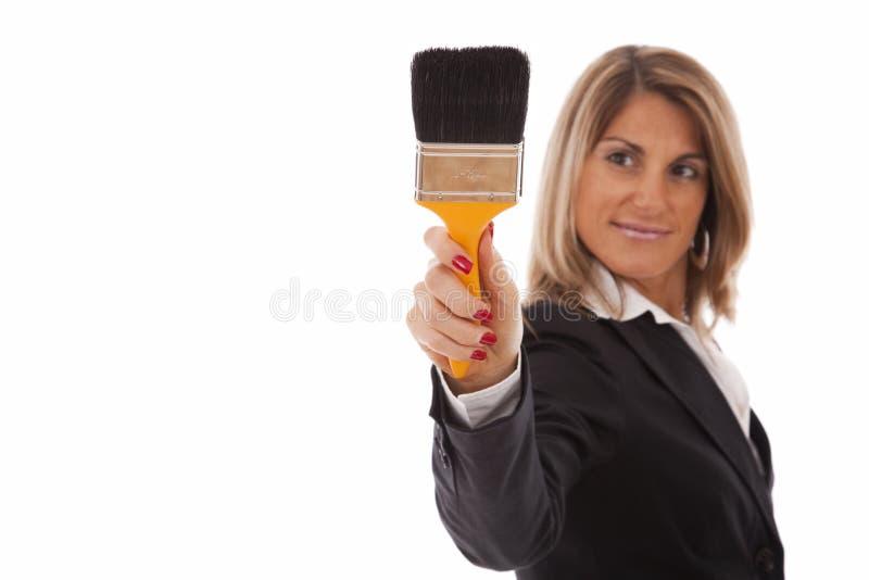Escrita da mulher de negócios no whiteboard fotos de stock royalty free