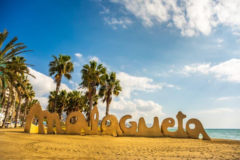 Escrita de Malagueta na praia Costa del Sol Spain de Malaga imagens de stock royalty free