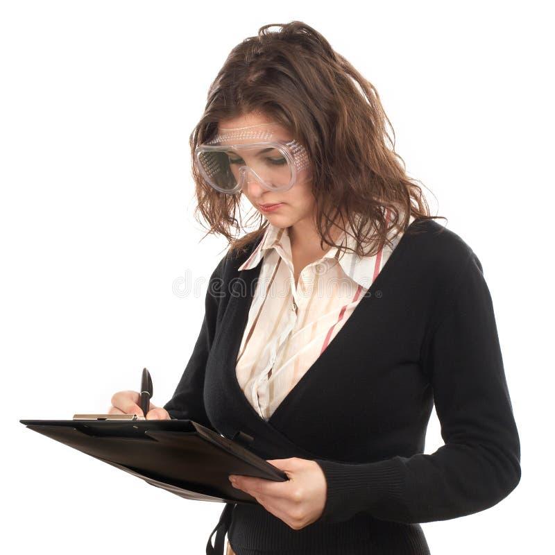 Escrita do coordenador da mulher imagens de stock
