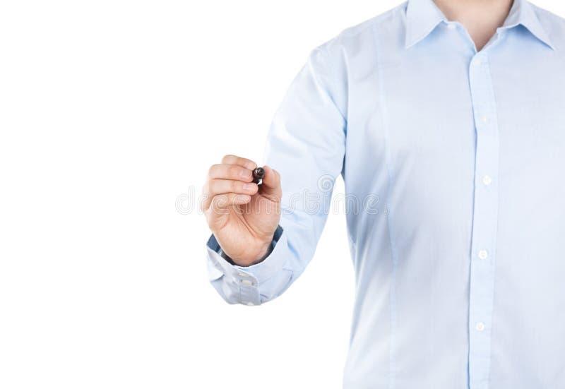 Escrita do homem novo com o marcador preto no fundo branco fotos de stock royalty free