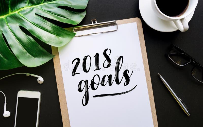 escrita do texto de 2018 objetivos no papel para cartas e nos acessórios imagem de stock royalty free
