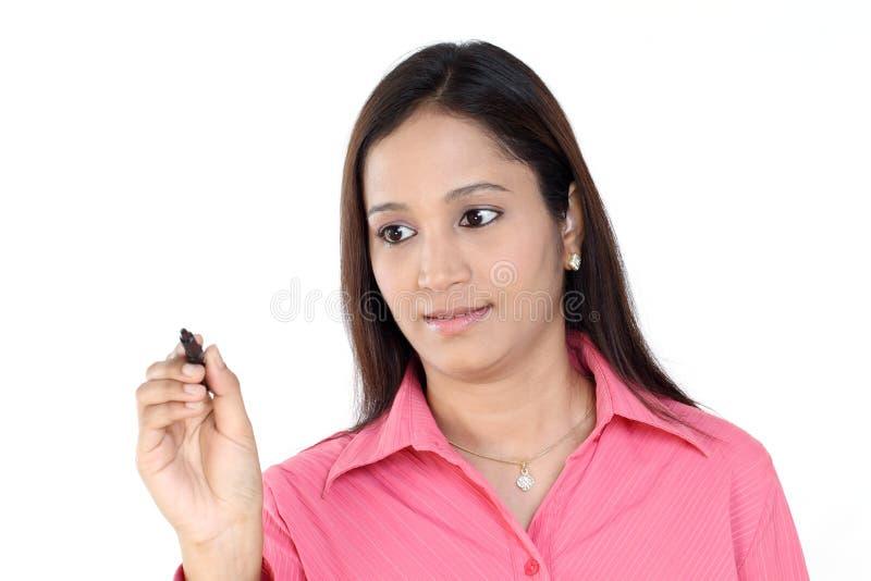 Escrita indiana da mulher de negócio imagem de stock royalty free