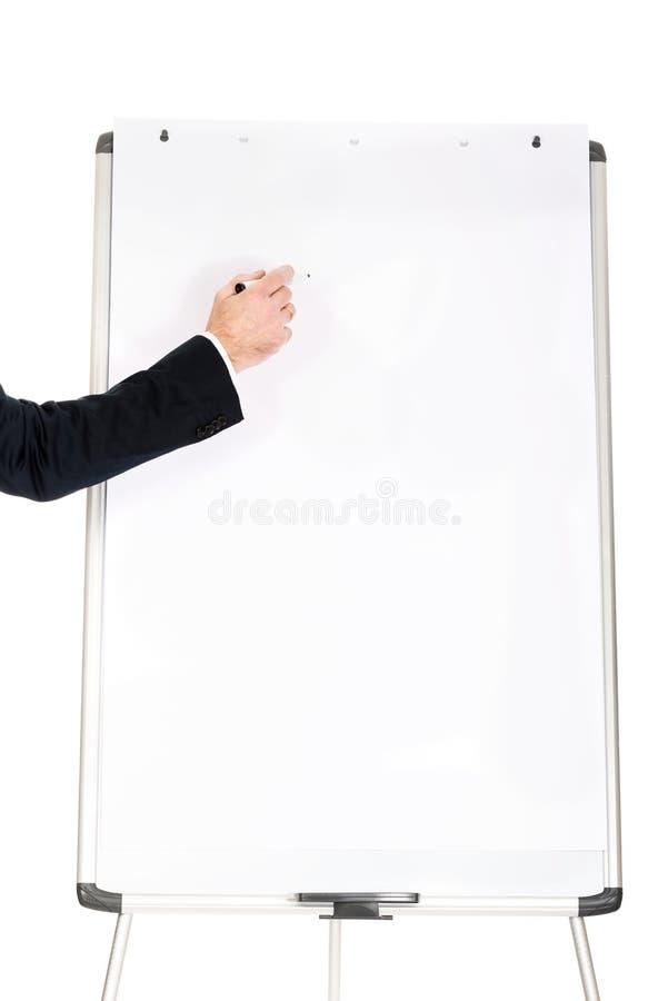 Escrita masculina da mão em um flipchart imagens de stock