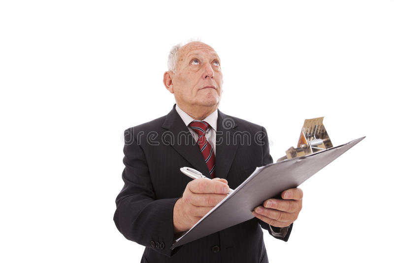 Escrita sênior do homem de negócios fotos de stock