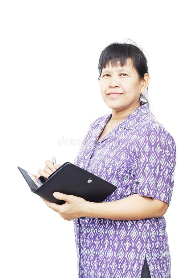 Escrita superior da mulher no organizador fotos de stock