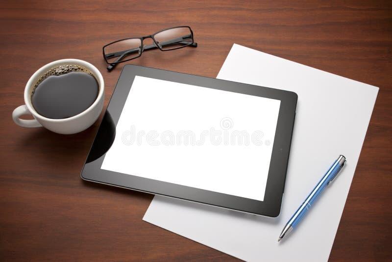 Escritorio del lugar de trabajo de la tablilla de Ipad fotografía de archivo