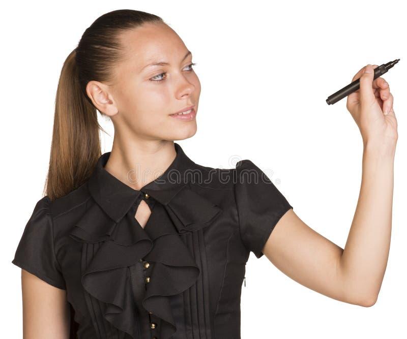 Escritura acertada joven de la mujer de negocios con la pluma fotos de archivo