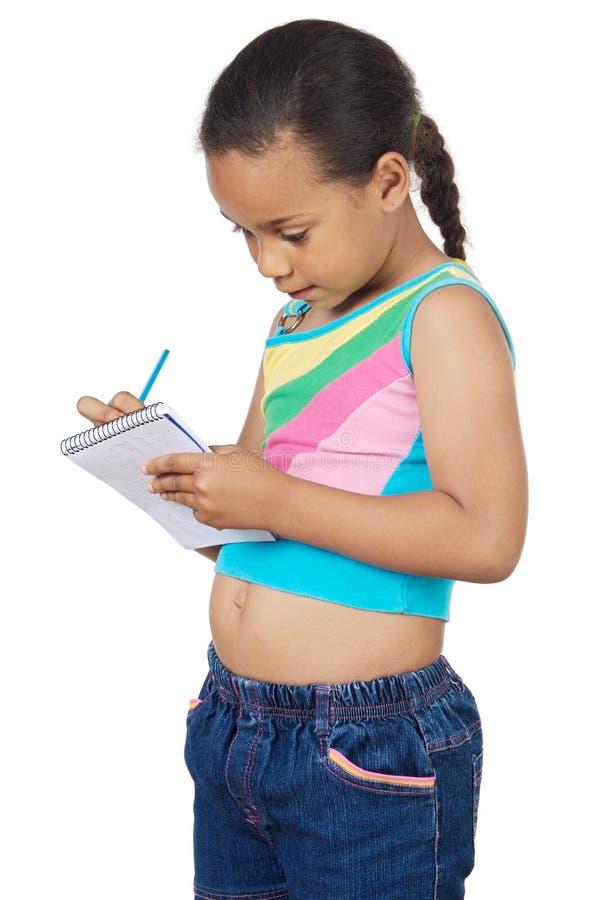 Escritura adorable de la muchacha imagen de archivo libre de regalías