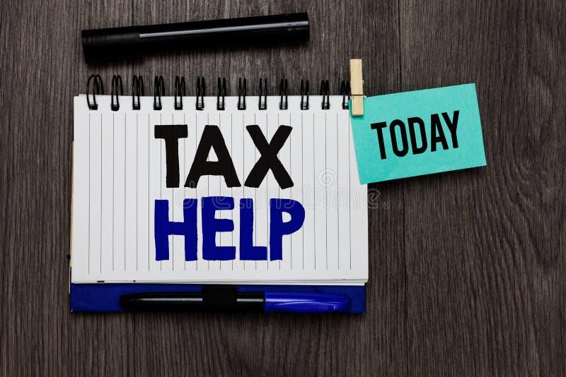 Escritura conceptual de la mano que muestra ayuda del impuesto Ayuda del texto de la foto del negocio de la contribución obligato fotos de archivo