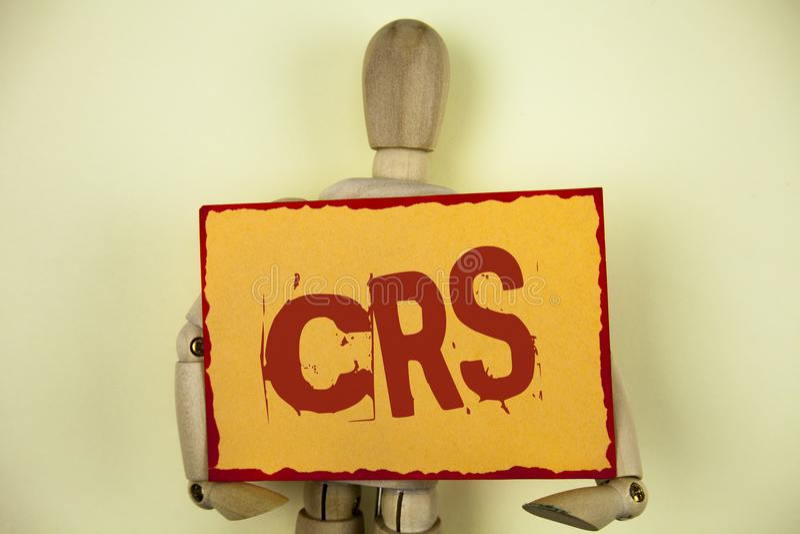 Escritura conceptual de la mano que muestra el CRS Estándar común de la información del texto de la foto del negocio para compart fotografía de archivo libre de regalías