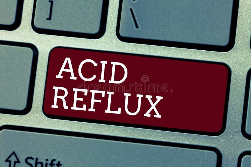 Escritura conceptual de la mano que muestra reflujo ácido Condición de exhibición de la foto del negocio a donde el ácido sostien imagenes de archivo