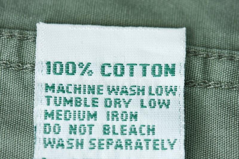 Escritura de la etiqueta 100% del algodón fotografía de archivo libre de regalías