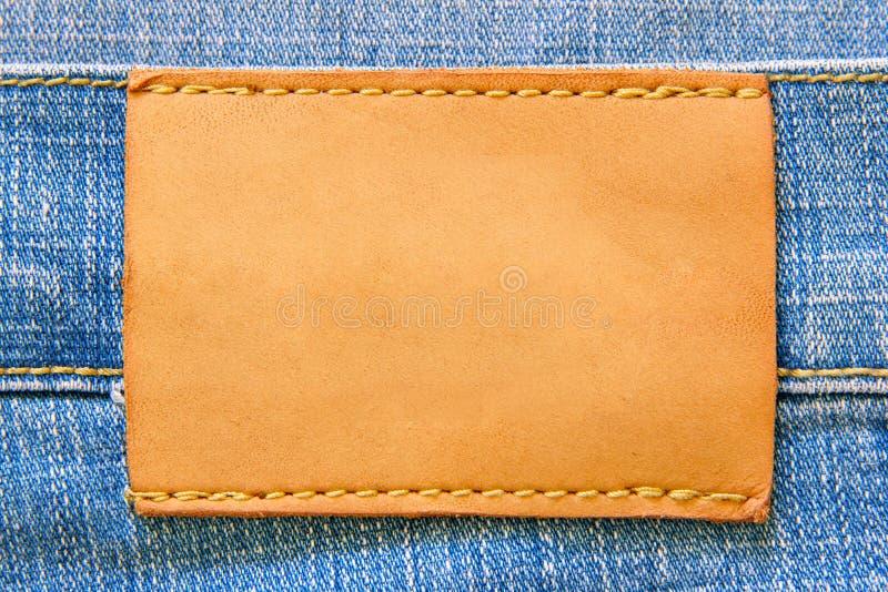 Escritura de la etiqueta de cuero en blanco fotografía de archivo