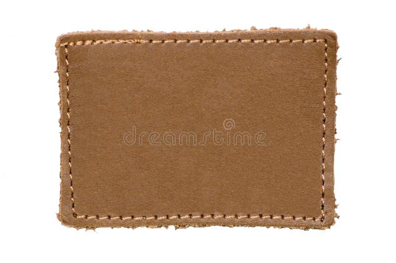 Escritura de la etiqueta de cuero en blanco aislada imágenes de archivo libres de regalías