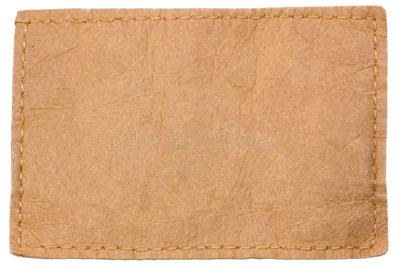 Escritura de la etiqueta de cuero en blanco ligera foto de archivo libre de regalías