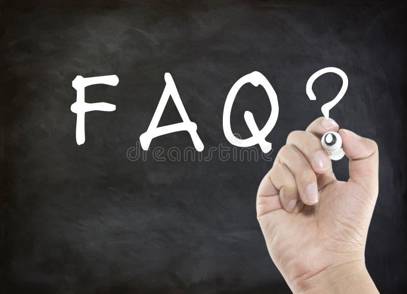 Escritura de la mano del FAQ imagen de archivo