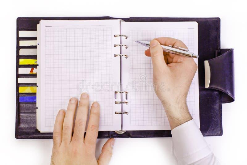 Escritura de la mano en un organizador fotografía de archivo libre de regalías