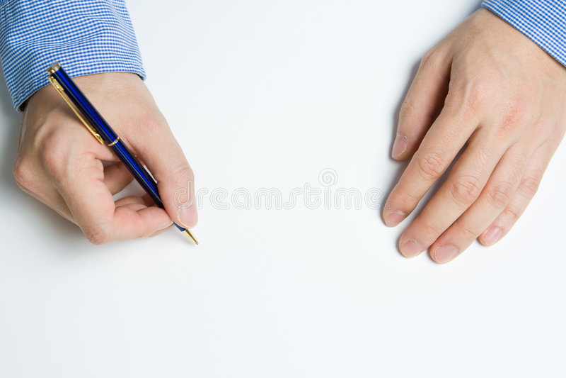 Escritura de la persona en el papel imagen de archivo libre de regalías