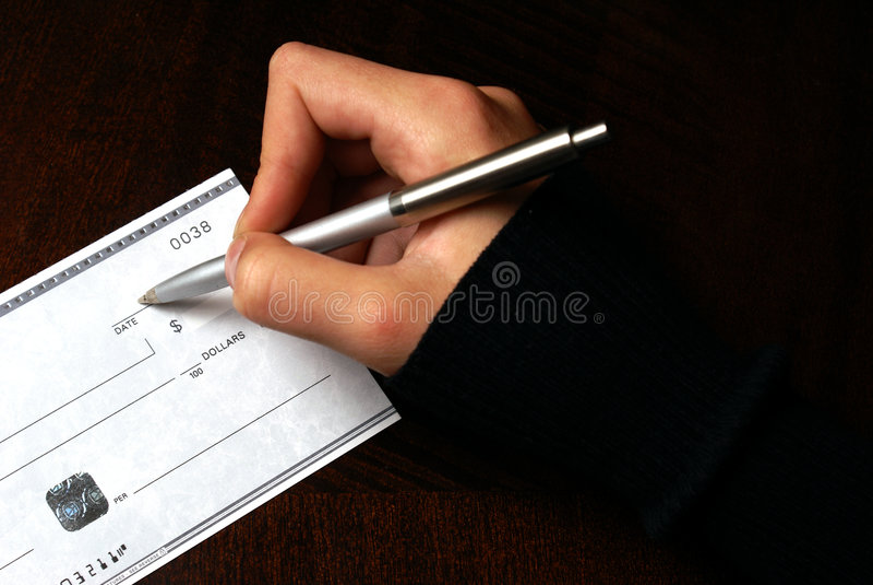Escritura de un cheque imágenes de archivo libres de regalías