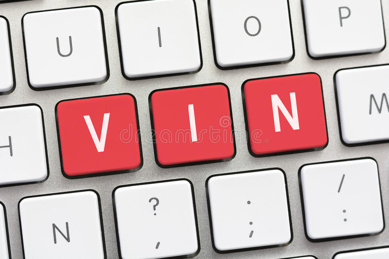 Escritura de VIN en el teclado blanco foto de archivo