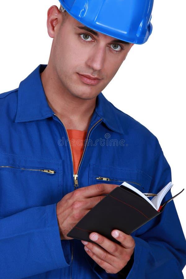 Escritura del comerciante en su orden del día fotos de archivo