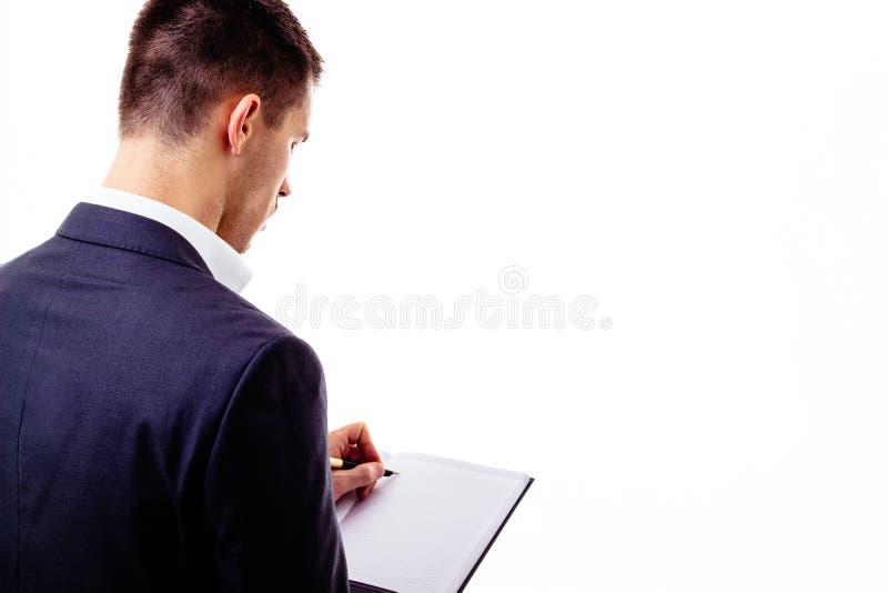 Escritura del hombre de negocios con la pluma imagen de archivo libre de regalías
