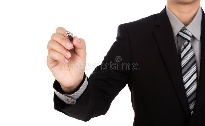 Escritura del hombre de negocios en espacio de la copia contra foto de archivo libre de regalías