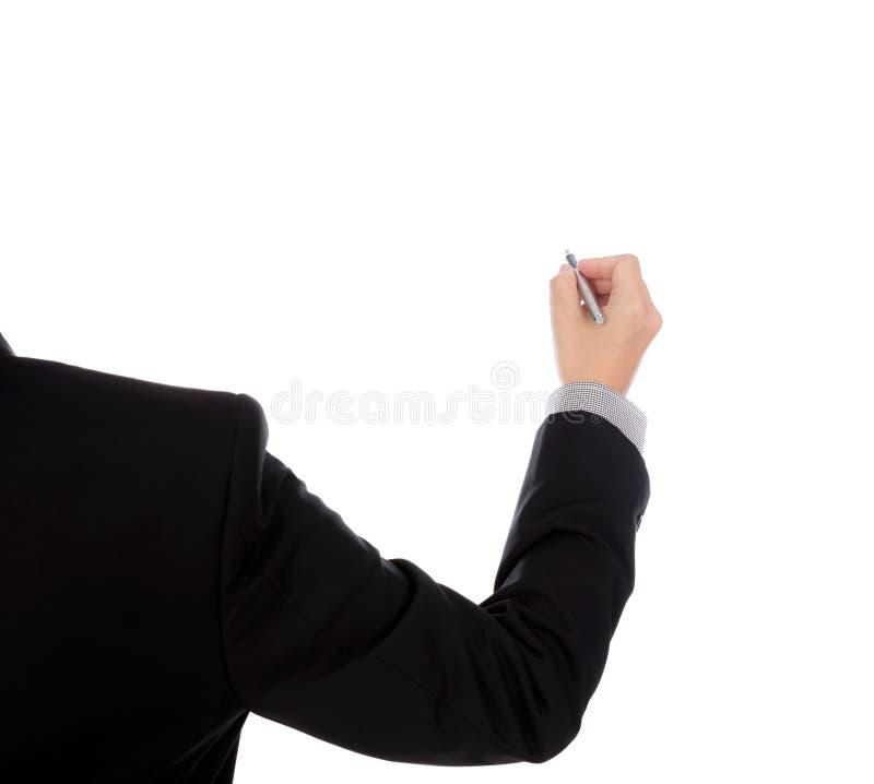 Escritura del hombre de negocios en espacio de la copia contra imagenes de archivo