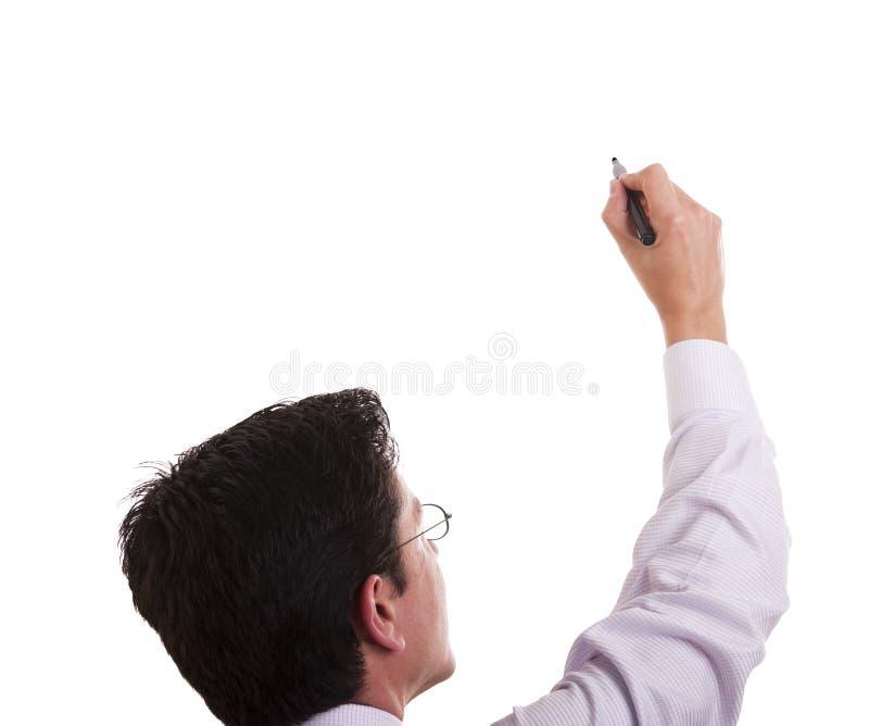Escritura del hombre de negocios en un whiteboard foto de archivo libre de regalías