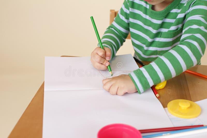 Escritura del niño, educación escolar imagenes de archivo