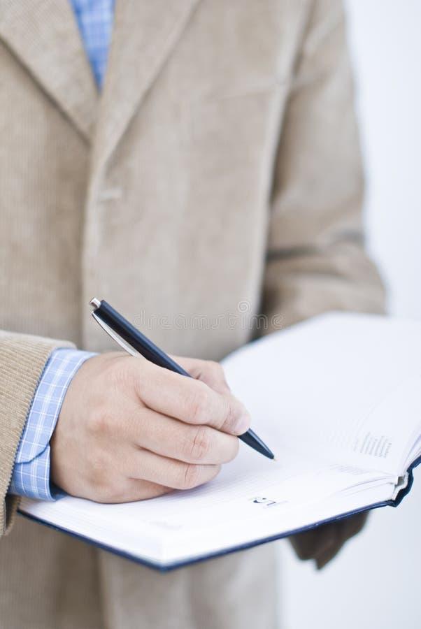 Escritura en agenda imagen de archivo