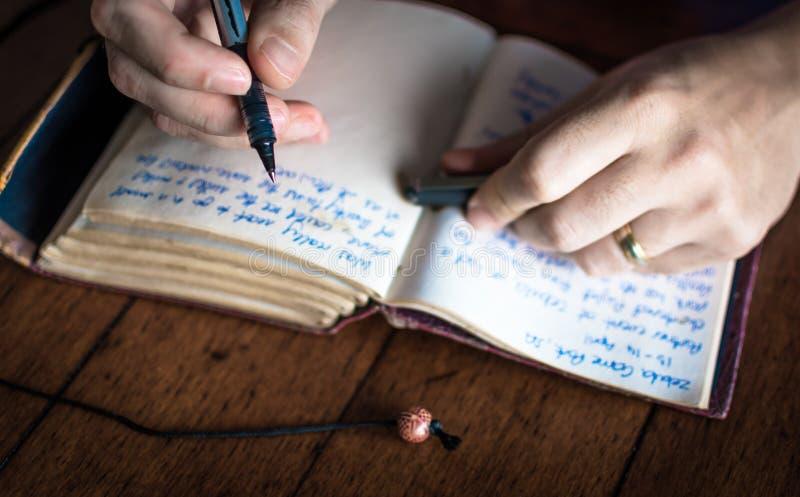 Escritura en diario foto de archivo libre de regalías