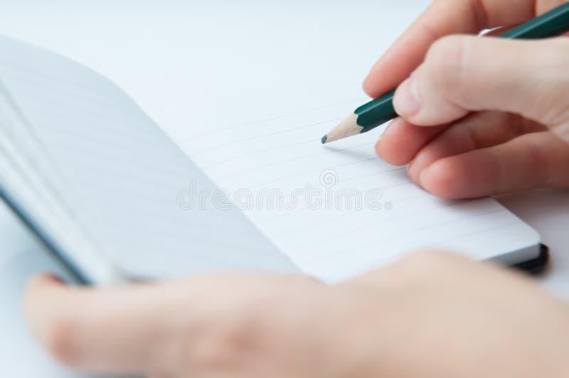 Download Escritura en el cuaderno imagen de archivo. Imagen de libro - 64209557