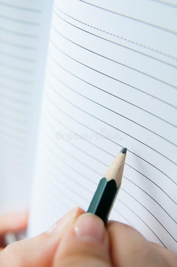 Escritura en el cuaderno imagenes de archivo