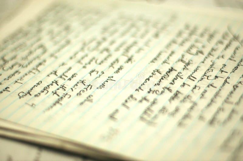 Escritura en el papel fotos de archivo