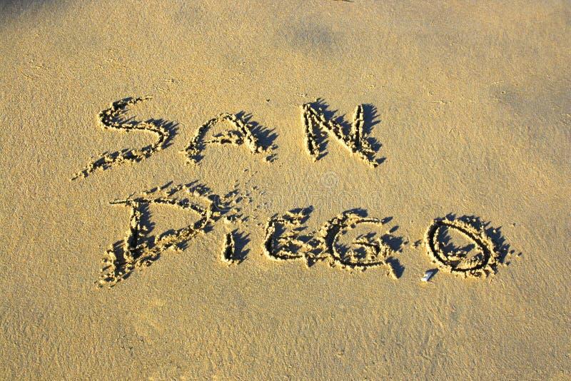 Escritura en la arena imagen de archivo libre de regalías