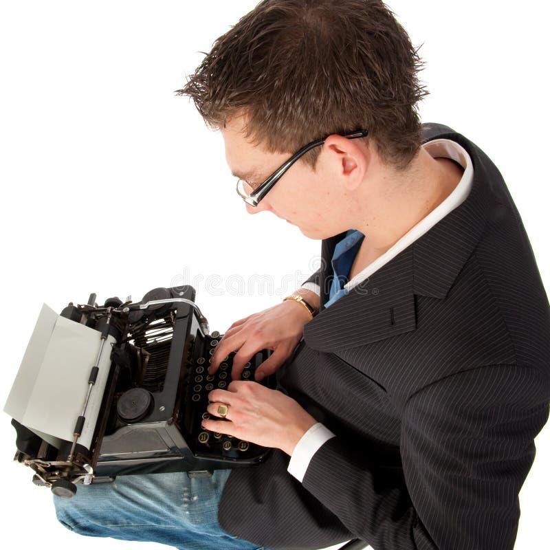 Escritura en la máquina de escribir vieja fotografía de archivo
